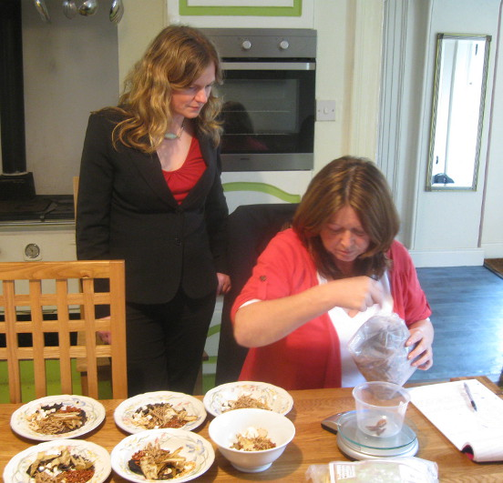 Postgraduate students learning to measure Chinese raw herbs.