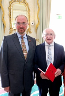 President of Ireland, Michael D Higgins, receiving a present of one of Prof Tom Shanahan's books, at the Aras in June 2016.