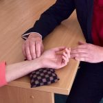 An Acupuncturist using Pulse diagnosis in the TCM clinic